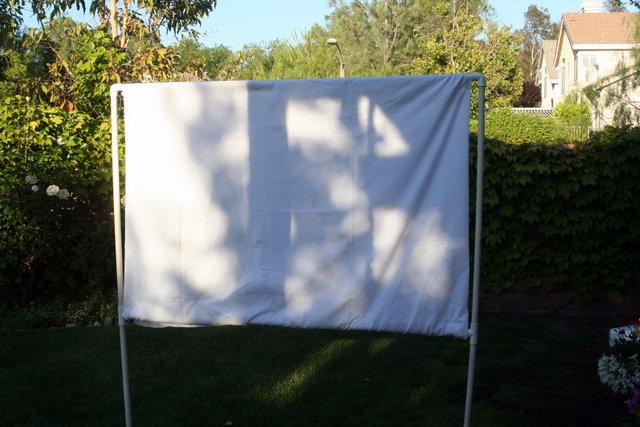 your own backyard movie screen host a movie party design dazzle