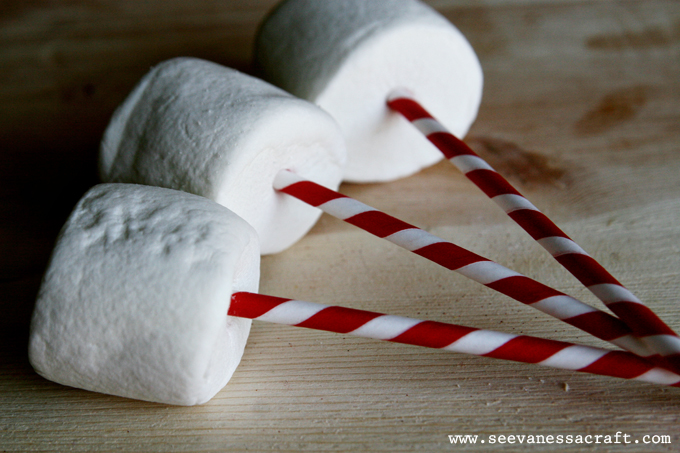 Marshmallow Snowman Pops featured on Design Dazzle.