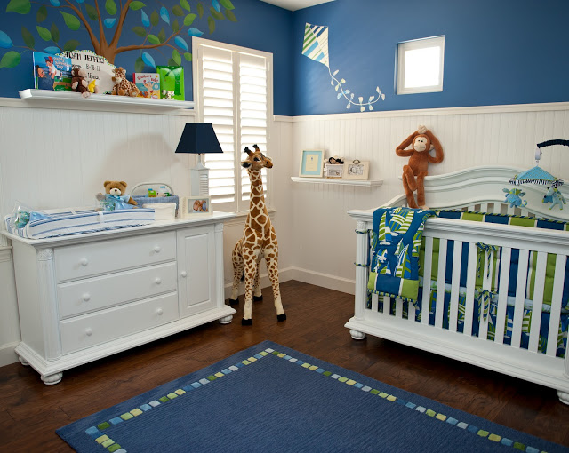 Adorable Monkey Business Nursery by Sue Vlautin of Red Geranium Interiors! Vibrant colors with cool wall murals and monkeys hanging from the ceiling!!