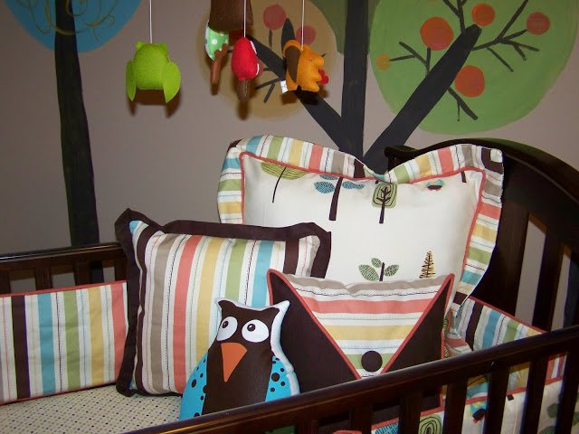 Adorable pillows and mobile for a gender neutral woodsy nursery! The the originality!