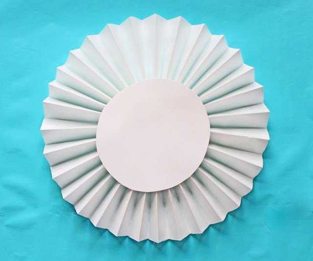 How to make extra-large rosettes out of paper window shades - Design Dazzle