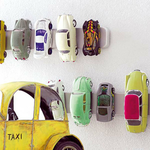 Magnetic strip toy car storage