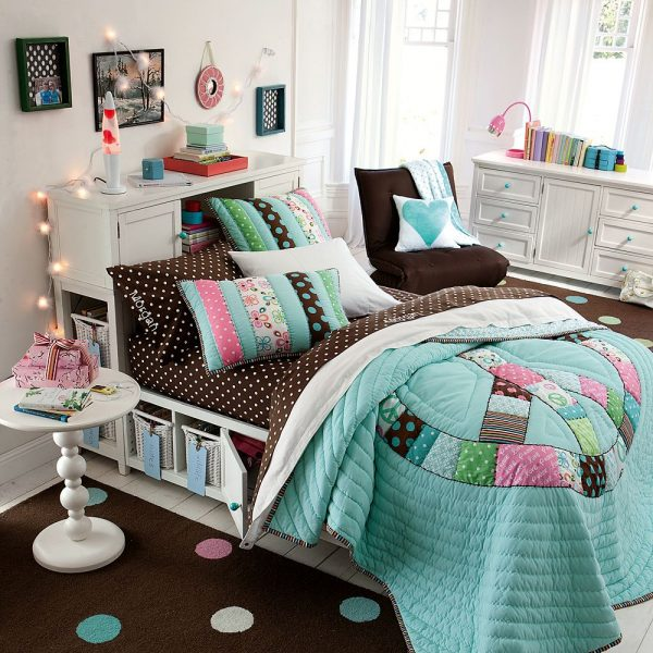 colorful bedspread in a teen girls bedroom