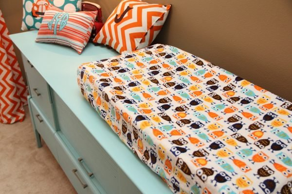 orange and turquoise baby nursery changing pad cover