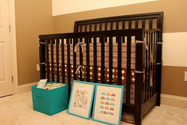 orange and turquoise baby nursery crib