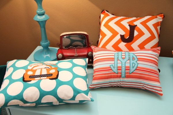 orange and turquoise baby nursery pillows