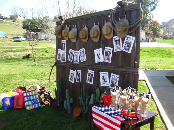 adorable display of cowboy hats and wanted posters