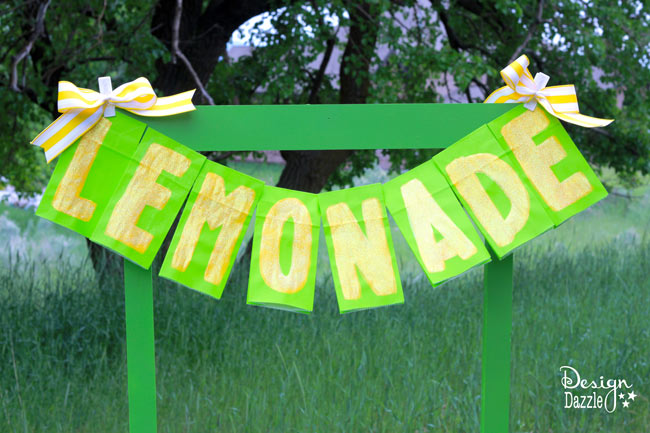 Lemonade Stand Banner made with green paper bags! So cute and easy - no cutting! Design Dazzle