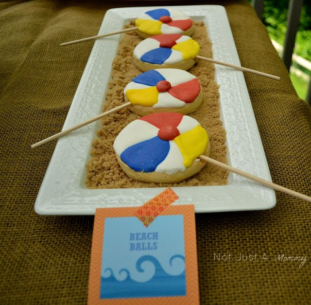 A Day At The Beach playdate party table beach ball cookies