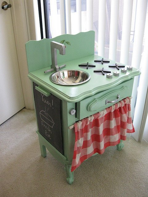 green and red play kitchen