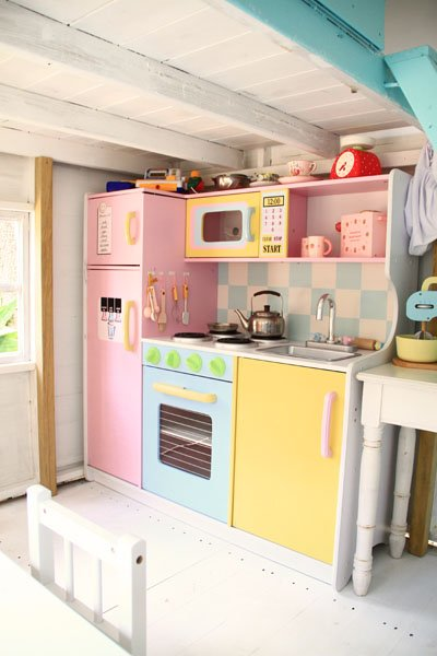 Pastel colored outdoor playhouse design dazzle for Playhouse kitchen ideas