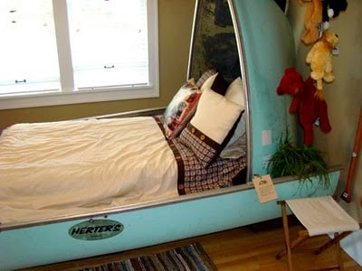 camping theme room using a canoe as the bed and headbord