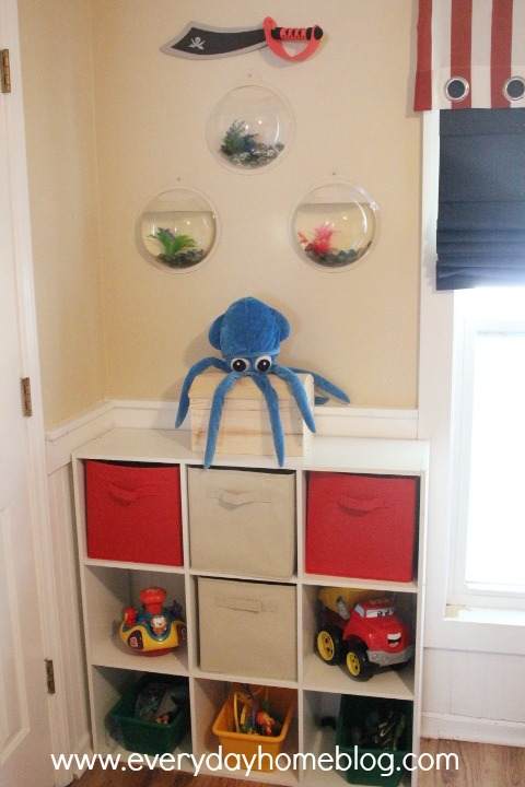 Barb found the cool port hole aquariums online and placed them