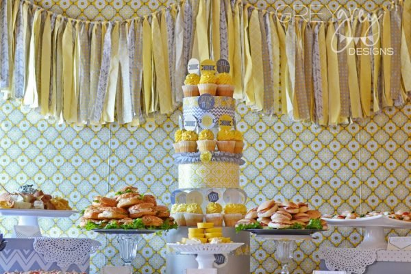 Yellow and Gray baby shower food table with a fabric garland backdrop