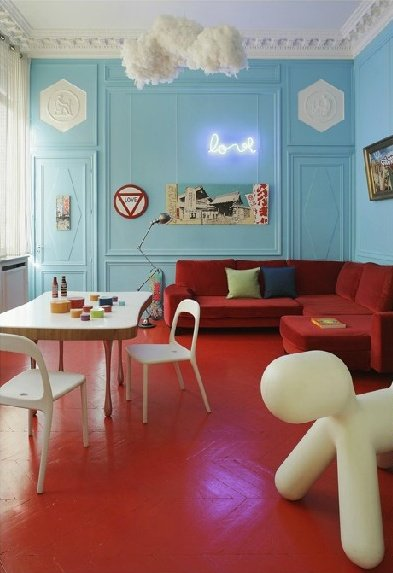 Red Painted Wood Floors In A Kids Hangout Room