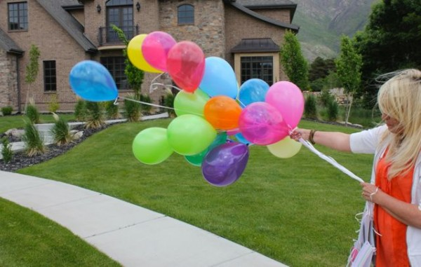 Taking balloons to a neighbor to let them know they are special and loved.