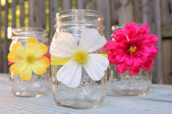 Mason Jar Wraps! Adorable flowers wrapped around mason jars featured on Design Dazzle