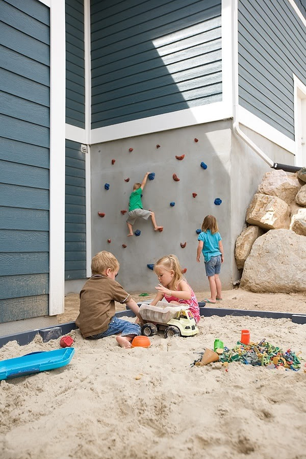 How Fun Is This Backyard?! I Love The Rock Wall And The Sandbox Together,  Kids Would Be Outside All Day Long With A Backyard Like This.