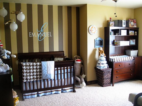 Brown stripes by the crib are fun in this Sock Monkey Nursery