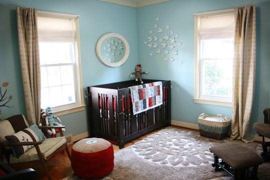Blue walls in a retro/modern Sock Monkey Nursery