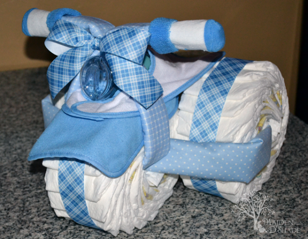 Fun diaper cakes for boys design dazzle for Baby shower decoration ideas with diapers