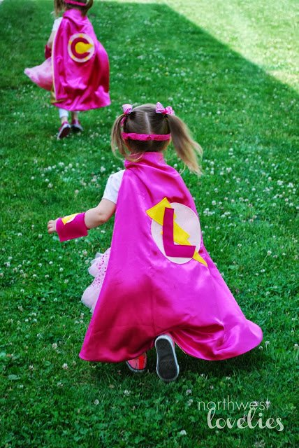 Pink Superhero capes for party guests featured on Design Dazzle