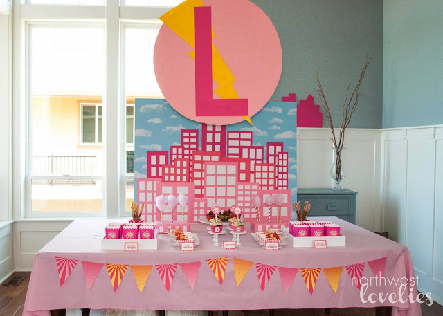 Cute pink Superhero party dessert table featured on Design Dazzle
