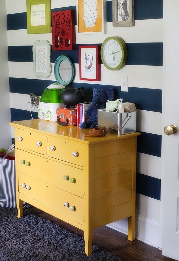 Stripes in a nursery are always a classic way to dress up the walls