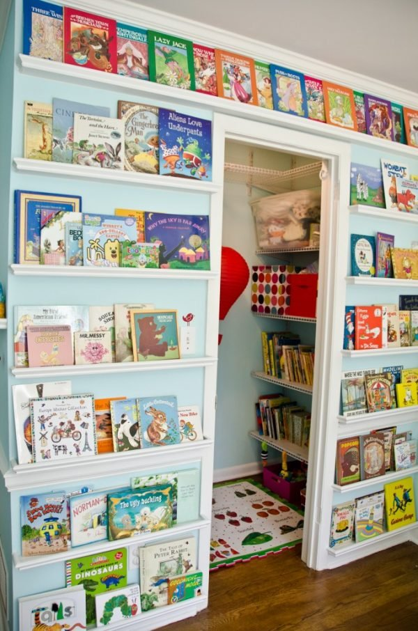 Wall of books for a nursery to instill an early love of reading