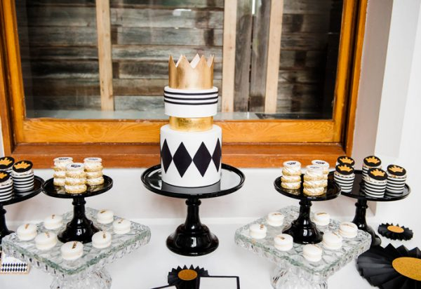 """""""Fit for a Prince"""" black and gold boy baby shower themed dessert table."""