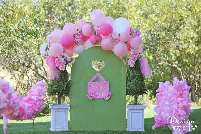 Make an oversized party ruffle out of a roll of paper towel! Resourceful, cheap, and darling!!! Easy tutorial on design dazzle.com! #fairyparty #DIYpartydecor