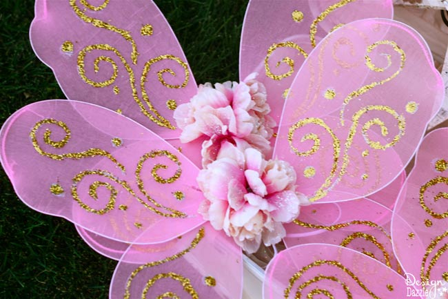 Make dollar store fairy wings FABULOUS! So quick and easy! Step-by-step tutorial on www.designdazzle.com! #fairyparty #diyfairywings