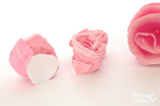 Rolled flowers to put on your darling cupcake baker hat! Step-by-step tutorial on design dazzle.com! #diygirlcostume #cupcakebakercostume
