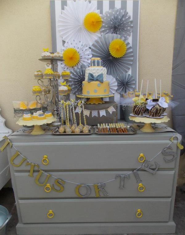 Tutus or Ties Gender Reveal party with a yellow and gray theme