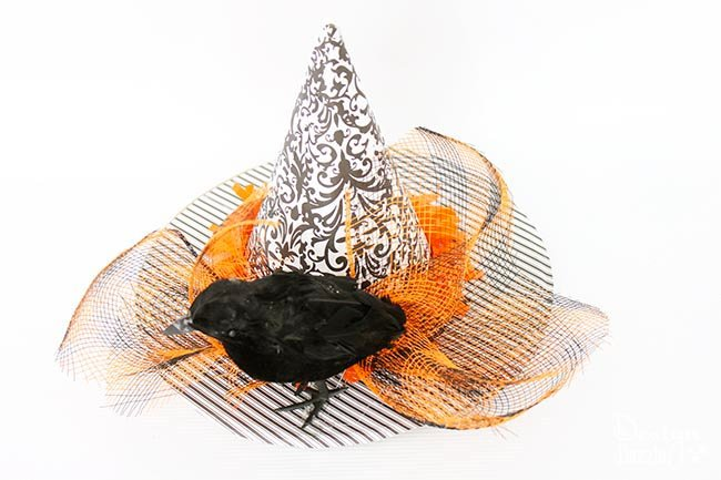 Quick and easy witches hat fascinator for mom, teen, or little girl costume! Designdazzle.com #diyhalloweencostume #easyhalloween