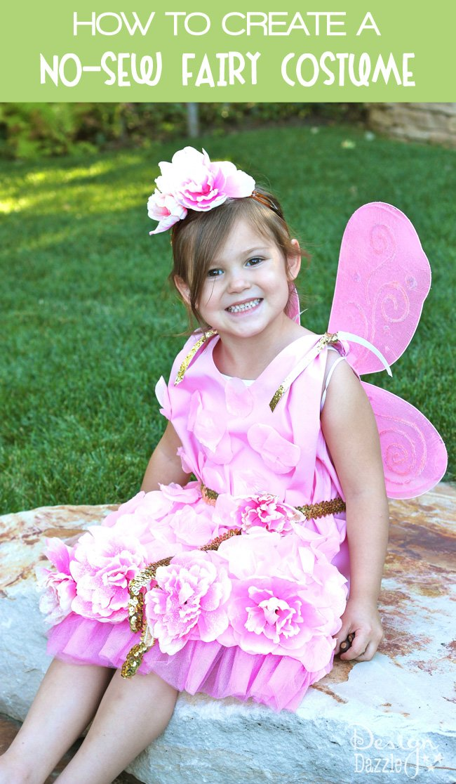 Can you believe this costume started as a pillowcase? Dollar store items were used to embellish this darling and inexpensive NO-SEW fairy costume! Design Dazzle #nosewcostume #fairycostume #pillowcasecostume #halloweencostume #nosewcostume