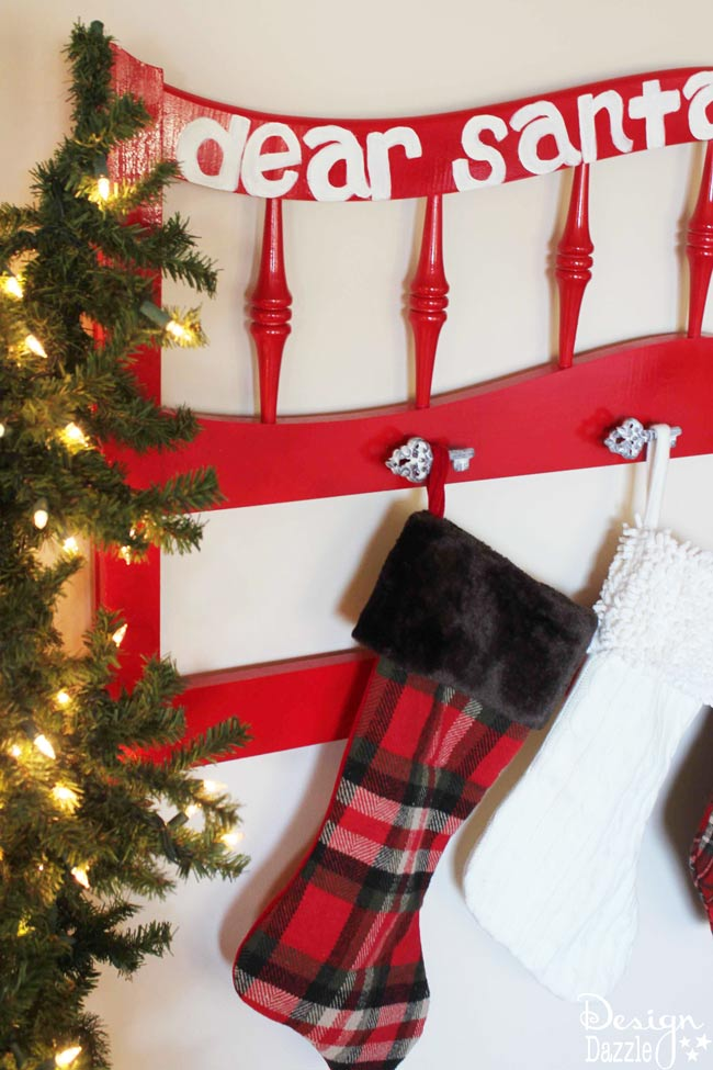 Don't have a fireplace with a mantel? Looking for a creative new way to display your cute stockings? Here's a fun DIY project to make a fabulous Christmas Stocking Holder. #repurposed #christmasdiy #christmasstockingholder