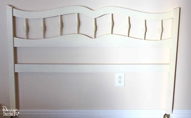 headboard repurposed into Christmas stocking holder