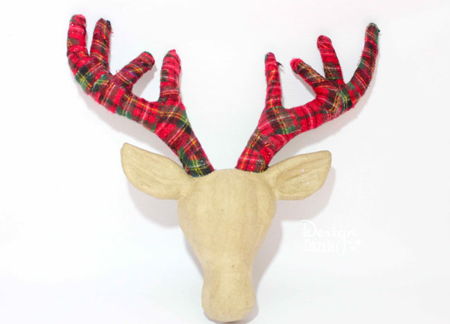 Adding plaid ribbon to the deer antlers gives it the perfect touch! Design Dazzle