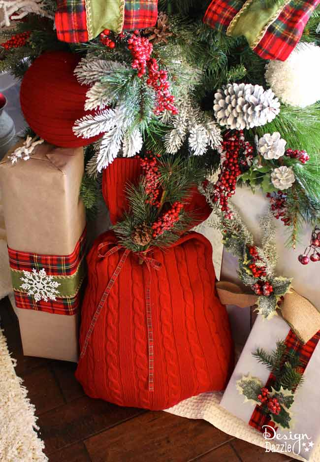 Repurpose an old sweater into a gift bag. Love the warm cozy look this sweater brings to our Christmas decor. Reuse it every year to wrap gifts. Use the glue gun or sew it! Design Dazzle #repurposed