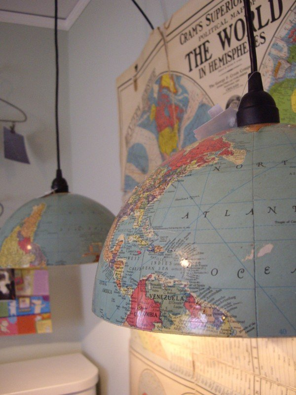 Rosebud's Cottage shows how to make a world globe into awesome light fixtures! See more awesome repurposing projects on Design Dazzle.