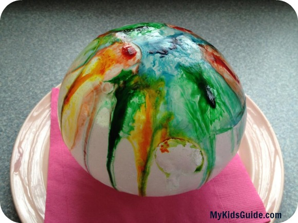 Make rainbow painted ice balls with the kids for a great indoor winter activity.