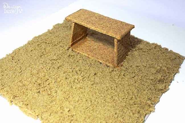 """Graham Cracker Houses: Making the stable for a nativity scene is the easiest part- and the cutest! Brown sugar is the best """"sand""""!"""