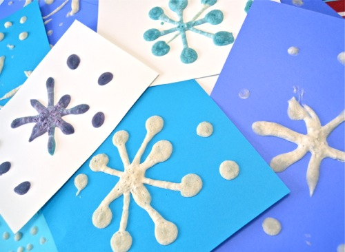 Puffy snowflake painting makes for a fun indoor winter craft for kids