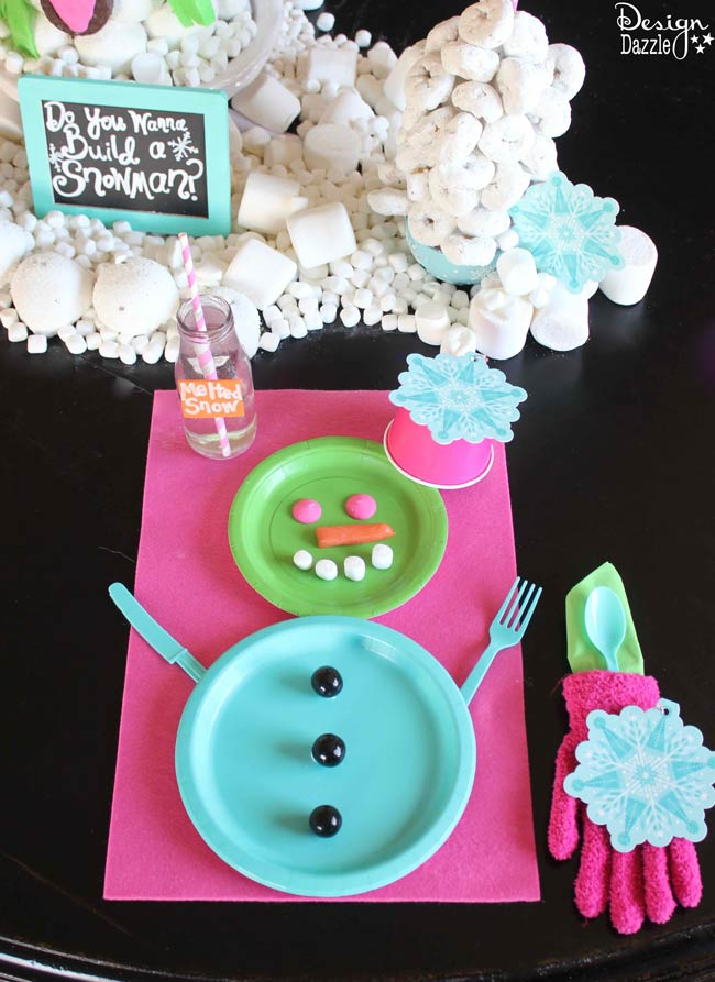 Edible Snowman Centerpiece made with Hostess Snack Cakes. Easy snowman placesetting.  Design Dazzle #HostessHoliday