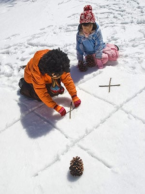 Play tic tac toe in the snow for a fun outdoor winter activity