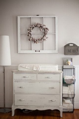 Don't you love this vintage nursery?! Love that antique window and classic wreath!