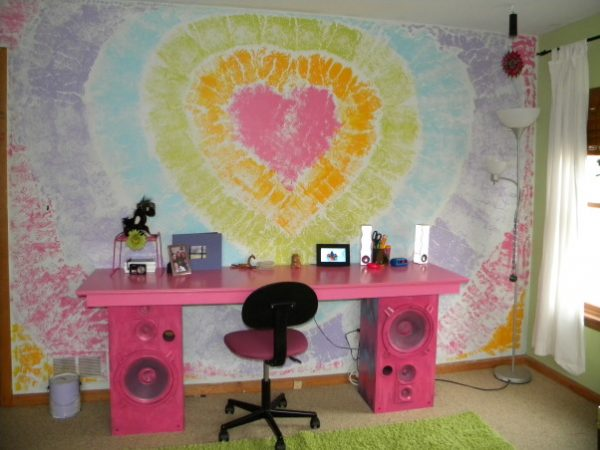 tie dye wall with an awesome desk made from recycled speakers