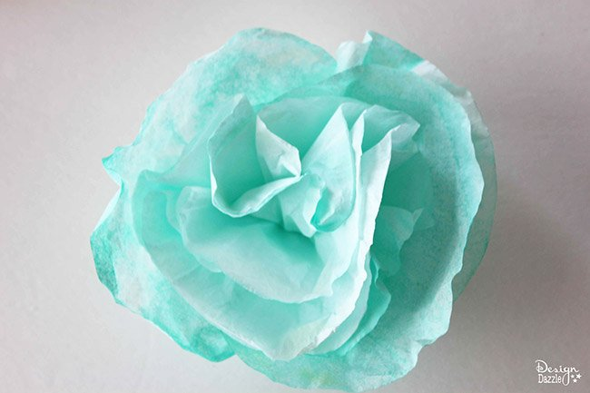 Check out this simple coffee filter flower tutorial on Design Dazzle. #DIY #partydecor #coffeefilterflowers