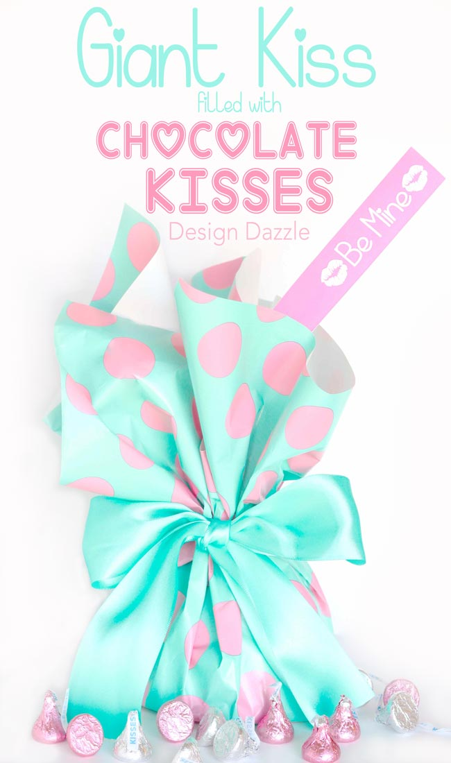 Instructions to make your own Giant Valentine Kiss filled with chocolate kisses! Free printables for Valentine slips! Design Dazzle